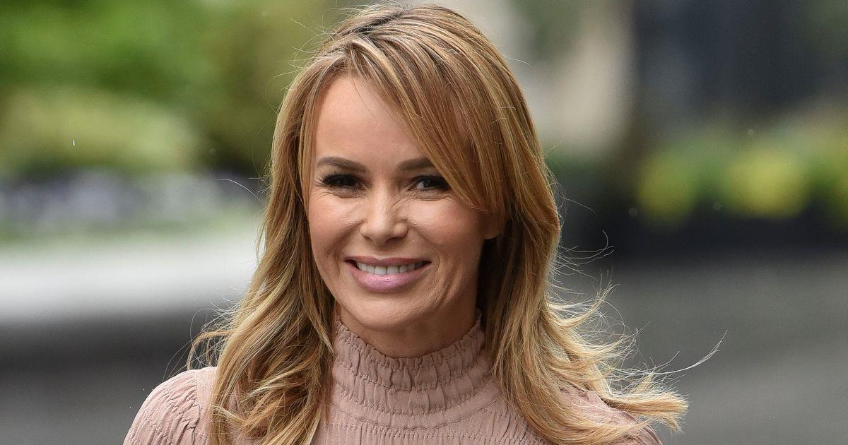 Amanda Holden strikes a sultry pose as she shows off her lavish new kitchen with statement lighting