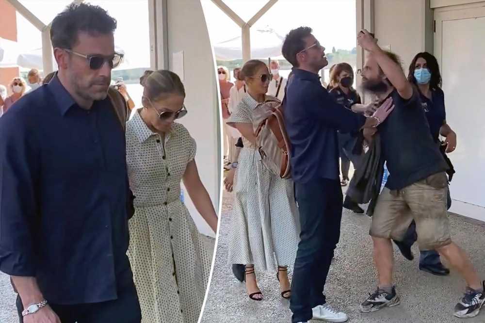 Ben Affleck checks overzealous fan looking for a selfie with Jennifer Lopez