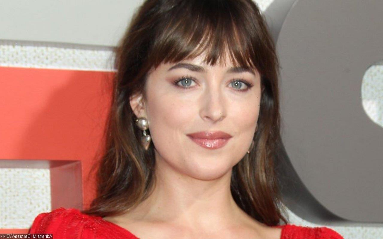 Dakota Johnson Dares to Bare in Sheer Gown at Venice Film Festival