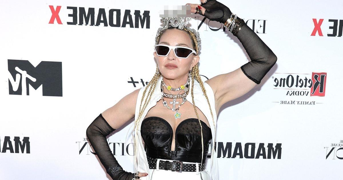 Madonna wows as she dons tiny bustier and fishnet tights in racy outfit display